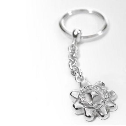 Mutschel Gebäck als Schlüsselanhänger in Silber